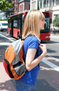 41566514 - blonde female student waiting for the bus