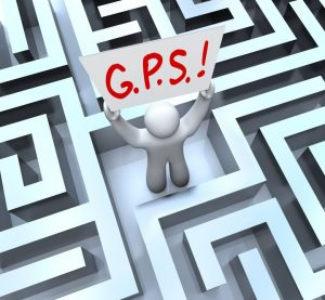 15875825 - the word or acronym for g.p.s. - global positioning system on a sign held up by a person lost in a maze or labyrinth